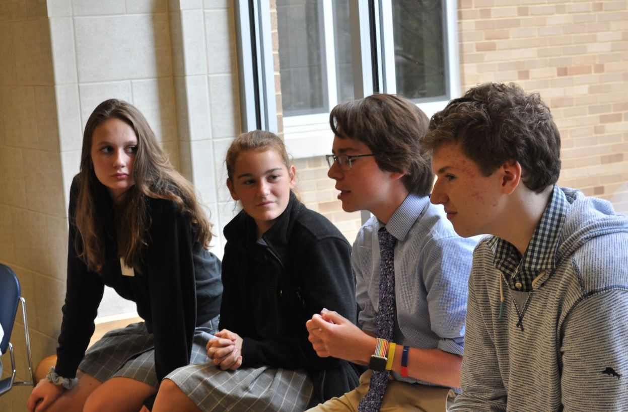 (Left to right) Chelsea Venters (Padua '21), Jessica Classen (Padua '20),  Aidan O'Neill ('19), and Joseph Rafalli ('21) discuss Metamorphoses and the  dynamic of SST's cast.