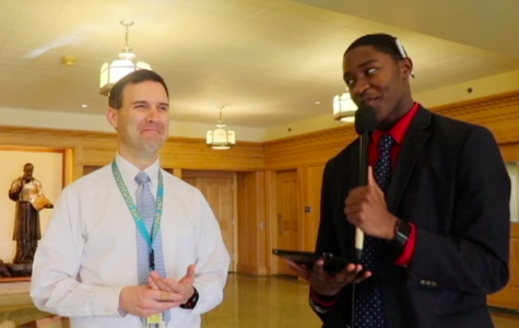 Darnell Vaughan '19 catches up with Mr. Szczerba in the hallway to play a little Thanksgiving Trivia.