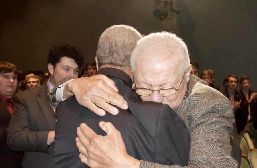 Mr. Fred Smith and Mr. James Owens embrace as they take the stage for the Quintus Day celebration at Salesianum.