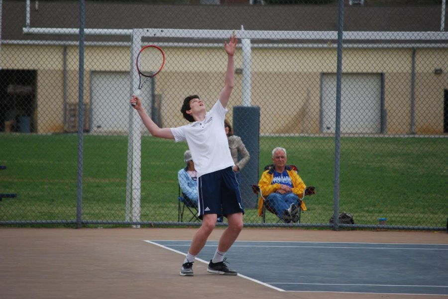 Patrick+Deely+sets+up+for+a+powerful+serve+against+his+Archmere+opponent.