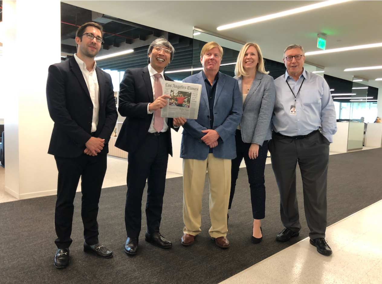 (From left to right) Matt Hamilton, L.A. Times owner Patrick Soon-Shiong, Paul Pringle, Harriet Ryan and executive editor Norman Pearlstine celebrate the Times' win Monday. (Photo courtesy of Rong-Gong Lin II, uploaded on the Daily Trojan)