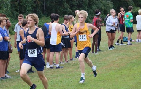 Junior Jack Kohn strides through the final straightaway to procure a personal best for himself and the team at White Clay Creek State Park.