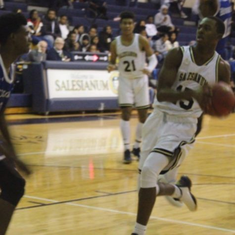 Rasheen Caulk (#15) leads the fast break down the court en route to a 20-point effort.