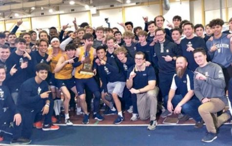 Members of the Salesianum Winter Track Team pose for a picture with the trophy after earning their 11th State Championship.