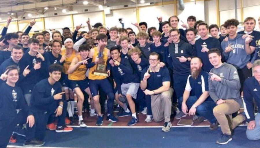 Members+of+the+Salesianum+Winter+Track+Team+pose+for+a+picture+with+the+trophy+after+earning+their+11th+State+Championship.