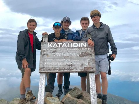 (From left to right) Matt Greenley '21, Joseph Rivell '21, Chris Przywara '21, Matt Deckers '21, and Jack Kohn '21 on top of Mount Katahdin in Maine. Before departing on the trip, the group was tested quarantined for 14 days.