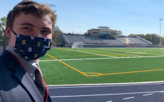 A proud Salesianum senior takes a tour of the upcoming Abessinio Stadium.