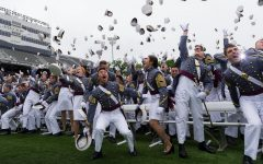 Graduates from the United States Military Academy at West Point celebrate their accomplishments with a ceremonial hat throw.