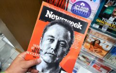 MIAMI, USA - AUGUST 23, 2018: Newsweek magazine with Elon Musk on main page in a hand. Newsweek is an American famous and popular weekly magazine