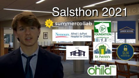 Student Council member Cal Walsh, '21 stands confidently with the eight chosen charities.